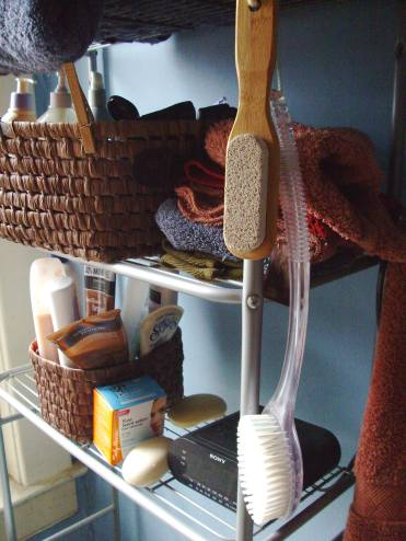A metal shelf with baskets containing shampoo